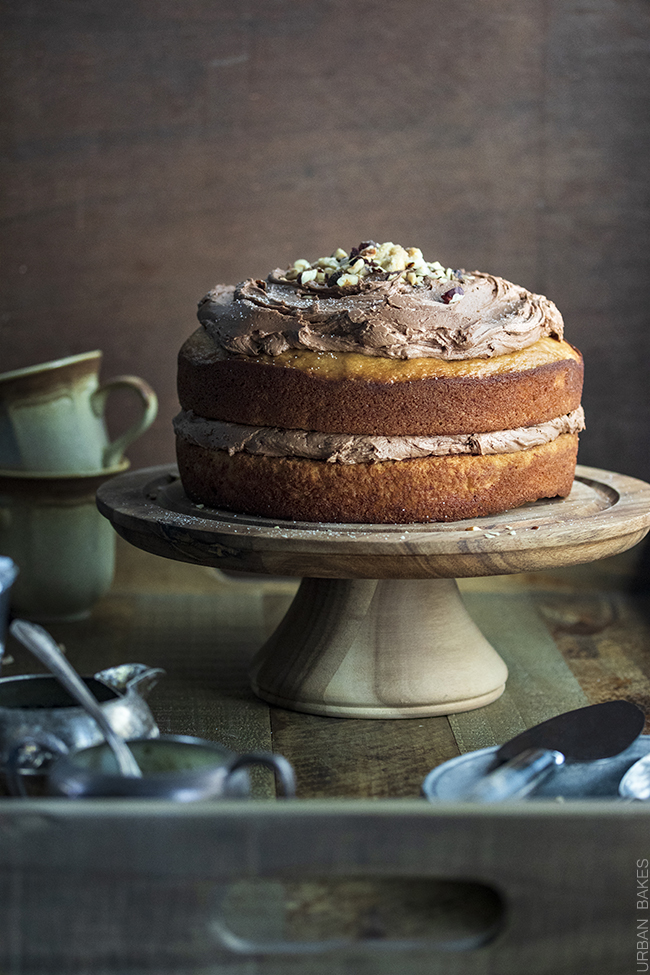 A Sweet and Nutty Banana Cake with Brown Sugar Hazelnut Buttercream and Toasted Praline Hazelnuts makes for a Simple yet Irresistible Treat!