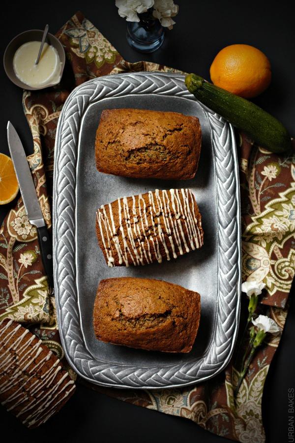 Orange Zucchini Bread with orange glaze.  Recipe makes 4 mini loaves. | urbanbakes.com