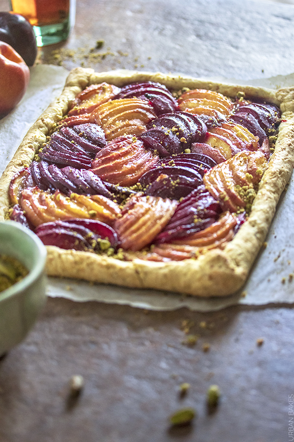 Summery Sweet and Tart Nectarine and Plum Galette with a touch of a mild nutty flavor added to a Homemade Buttery, Flaky Pistachio Nut Crust.  A Simple Fruit Dessert with a Beautiful play on Colors and Texture.