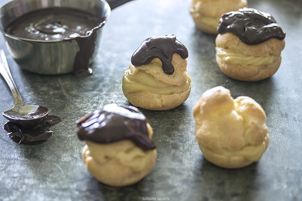 Classic Cream Puffs filled with Pastry Cream and poured ganache | URBAN BAKES